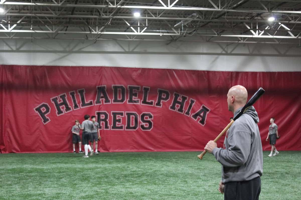 Philadelphia Reds teacher practicing with students, baseball training