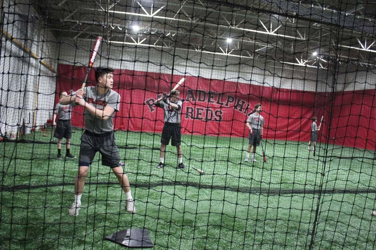 students training baseball at Philadelphia reds baseball academy
